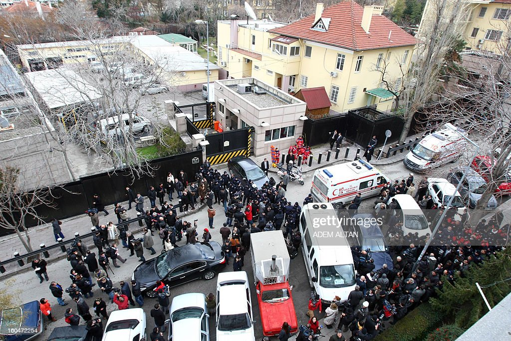 General view shows police and forensic experts working on February 1, 2013 at the site of a blast outside the US Embassy in Ankara. Two security guards were killed in the blast outside the US embassy, local television reported, amid speculation it was a suicide attack. The force of the explosion damaged nearby buildings in the Cankaya neighborhood where many other state institutions and embassies are also located.