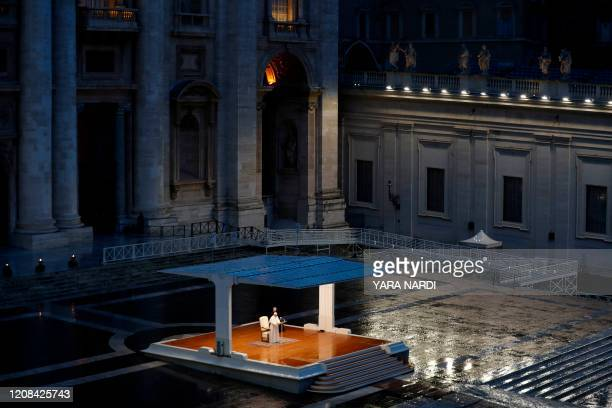 TOPSHOT A general view shows Pope Francis presiding over a moment of prayer on the sagrato of St Peters Basilica the platform at the top of the steps...