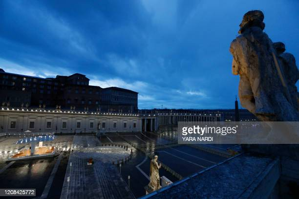 A general view shows Pope Francis presiding over a moment of prayer on the sagrato of St Peters Basilica the platform at the top of the steps...