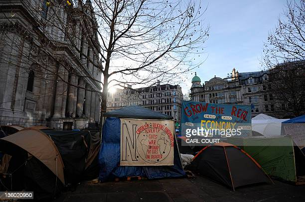 A general view shows posters and tents forming part of the the Occupy London Stock Exchange protest camp outside St Paul's Cathedral in central...