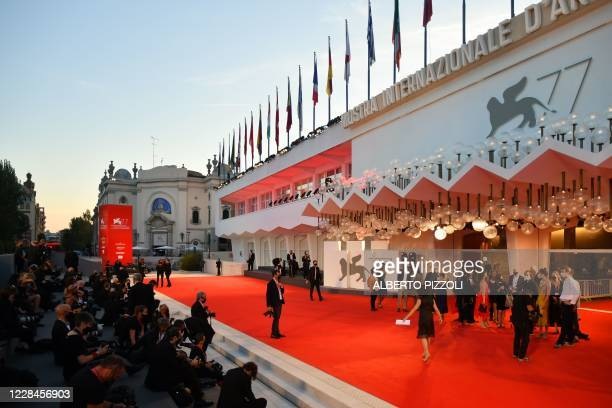 """General view shows press photographers waiting for guests to arrive at the festival's palace for the screening of the film """"Nomadland"""" presented in..."""