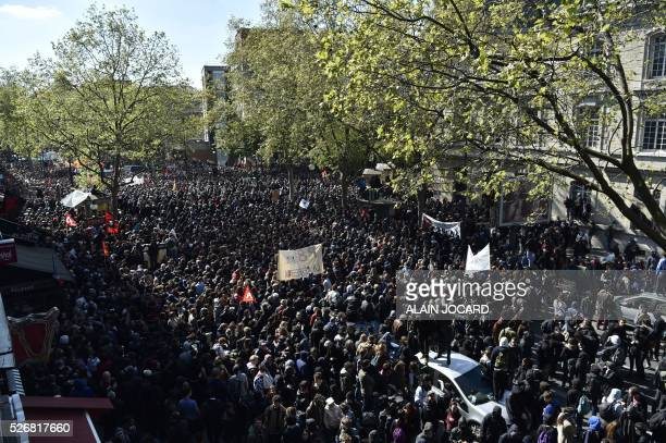 TOPSHOT A general view shows protesters attending the traditional May Day demonstration in Paris on May 1 2016 / AFP / ALAIN JOCARD
