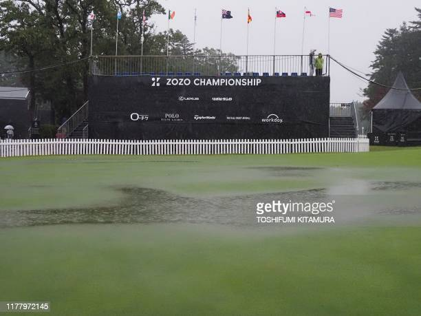 General view shows rain falling on the practice green of the PGA ZOZO Championship golf tournament as the Friday tournament had been postphoned due...