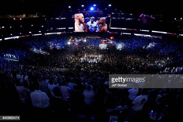 A general view shows referee Robert Byrd giving instructions to Floyd Mayweather Jr and Conor McGregor before their super welterweight boxing match...