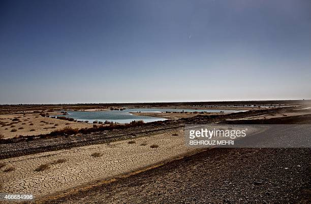 A general view shows remaining water in some parts of Hamoon wetland near the Zabol town in southeastern province of SistanBaluchistan bordering with...