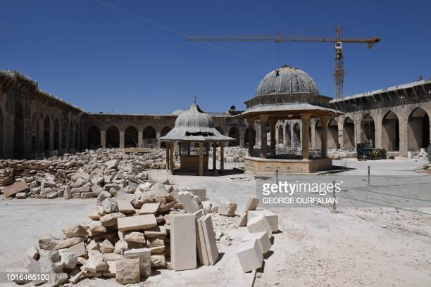 A general view shows renovation work at the historic Grand Umayyad mosque in the northern Syrian city of Aleppo on August 14 almost two years after...