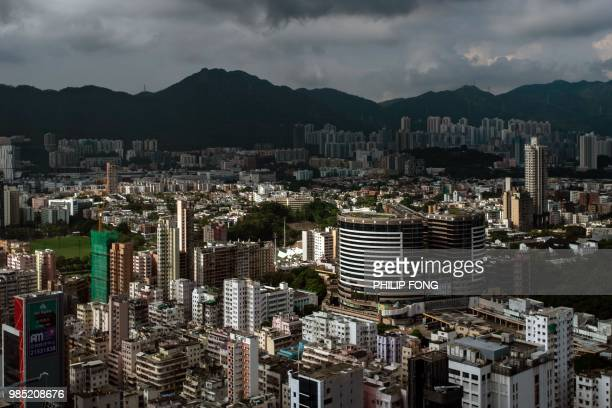 A general view shows residential and commercial buildings at Kowloon district in Hong Kong on June 27 2018