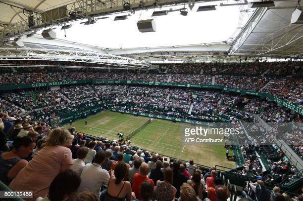 A general view shows Roger Federer from Switzerland and Florian Mayer from Germany during the ATP tournament tennis match in Halle western Germany on...