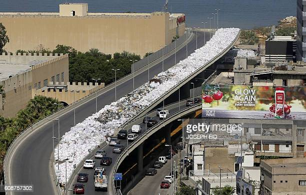 TOPSHOT A general view shows rubbish bags piled up on the side of the road in the Jdeideh neighbourhood north of Beirut on September 20 2016 / AFP /...