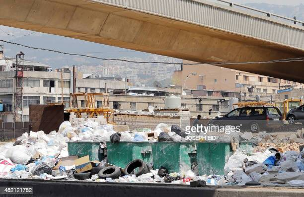 A general view shows rubbish piled up on the street in the Lebanese capital Beirut on July 27 2015 Trash collection resumed in Beirut after an almost...