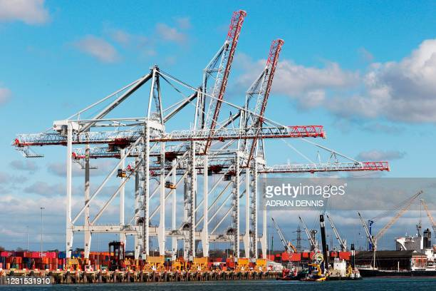 General view shows shipping containers on the docks in the Port of Southampton, on the south coast of England, on March 5, 2021. - Britain's...