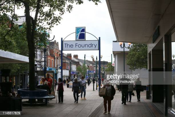 General view shows shoppers on the high street in Scunthorpe, north east England on May 22, 2019. - British Steel collapsed on Wednesday after the...