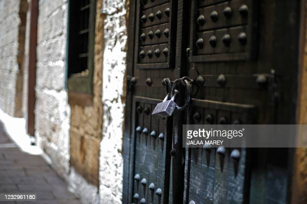 General view shows shuttered stores in the Israeli city of Acre during a general strike which was observed on May 18, 2021 in Arab neighbourhoods in...