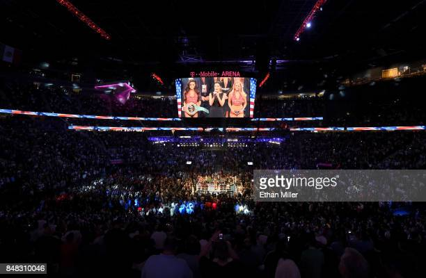 A general view shows singer Courtney Laine Mazza performing the American national anthem prior to the WBC WBA and IBF middleweight championship bout...