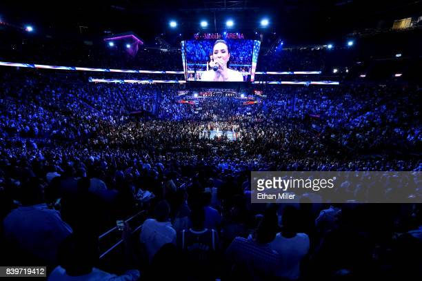 A general view shows singer/songwriter Demi Lovato performing the American national anthem prior to the super welterweight boxing match between Floyd...