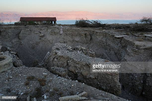 A general view shows sinkholes in Israel's abandoned tourist resort of Ein Gedi on the shore of the Dead Sea on July 11 2016 Experts have warned that...