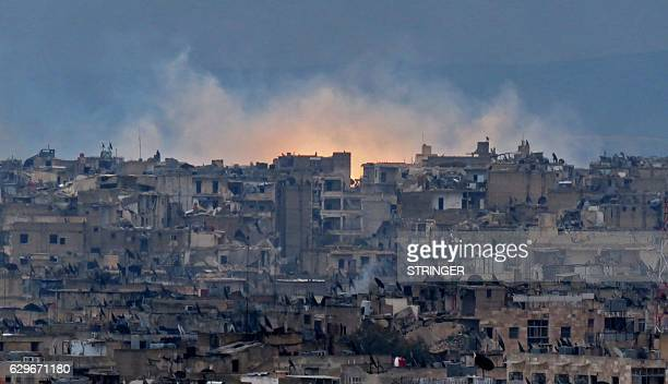 TOPSHOT A general view shows smoke and flames rising from buildings in Aleppo's southeastern alZabdiya neighbourhood following government strikes on...