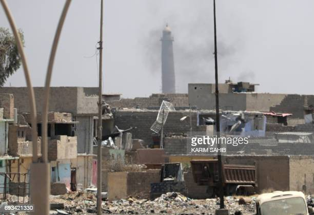 A general view shows smoke rising near the leaning AlHadba minaret in the AlNuri mosque compound as Iraqi government forces advance in western...