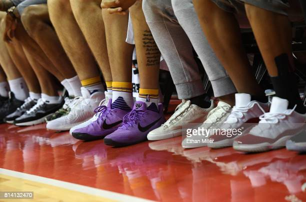 A general view shows sneakers worn by the Los Angeles Lakers players sitting on the bench during the team's 2017 Summer League game against the...