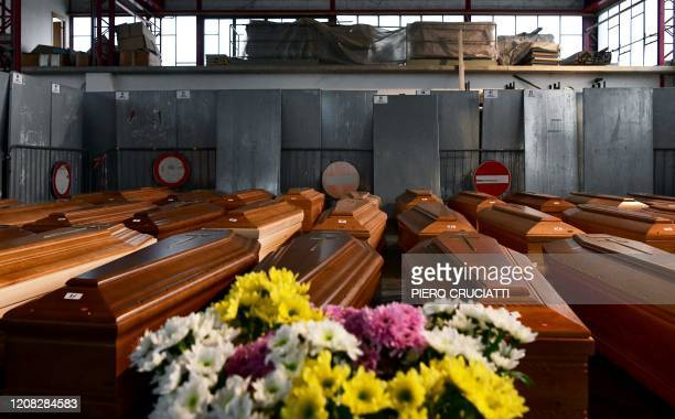 General view shows some of 35 coffins of deceased people stored in a warehouse in Ponte San Pietro, near Bergamo, Lombardy, on March 26, 2020 prior...
