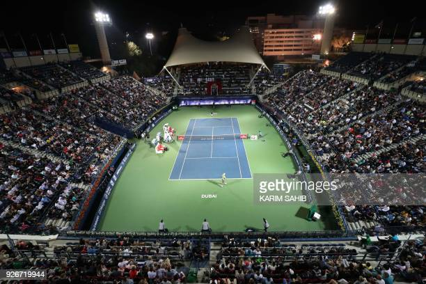 A general view shows Spain's Roberto Bautista Agut playing against Lucas Pouille of France during their final match in the 2018 ATP Dubai Duty Free...