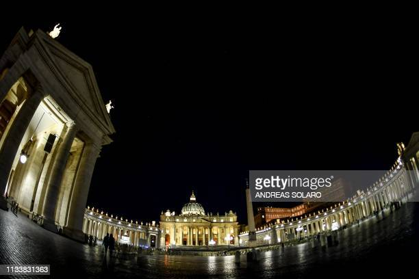 A general view shows St Peter's basilica St Peter's square and its colonnades before being plunged into darkness for the Earth Hour environmental...