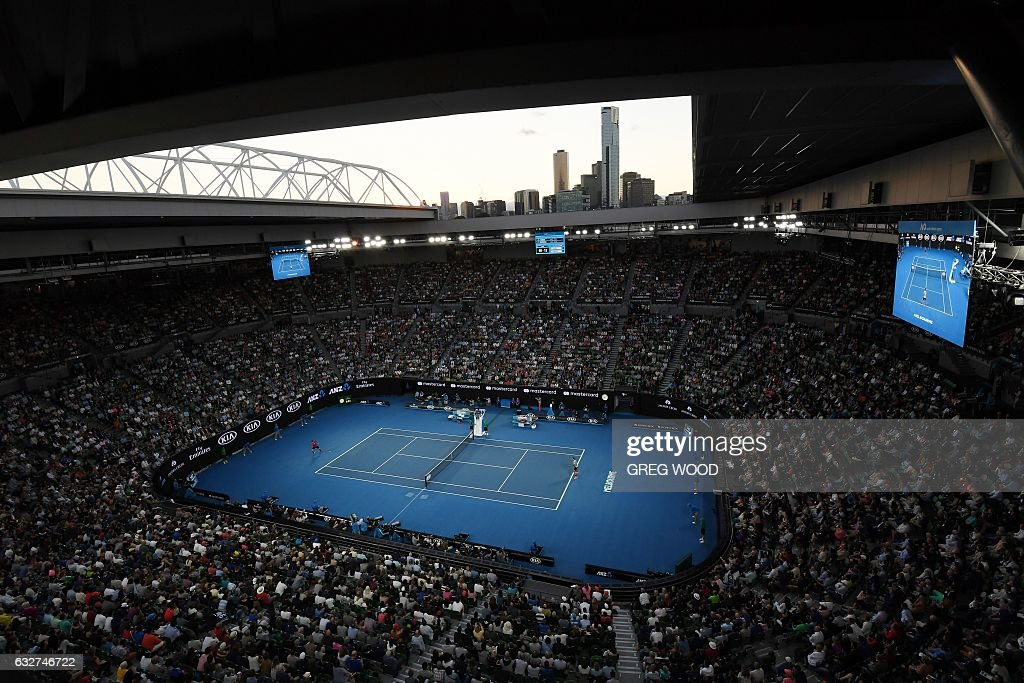 TOPSHOT - A general view shows Switzerland's Stanislas Wawrinka (L) playing against compatriot Roger Federer during their men's singles semi-final match on day 11 of the Australian Open tennis tournament in Melbourne on January 26, 2017. / AFP / GREG