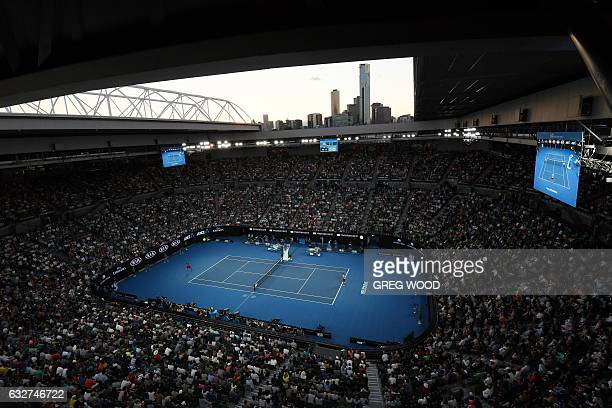 TOPSHOT A general view shows Switzerland's Stanislas Wawrinka playing against compatriot Roger Federer during their men's singles semifinal match on...