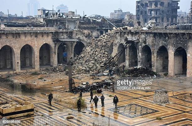 TOPSHOT A general view shows Syrian progovernment forces walking in the ancient Umayyad mosque in the old city of Aleppo on December 13 after they...