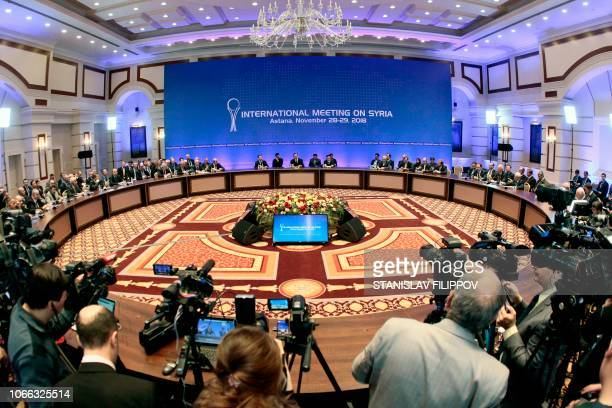 A general view shows Syrian regime representatives opposition delegates and other attendees as they take part in the plenary session of Syria peace...