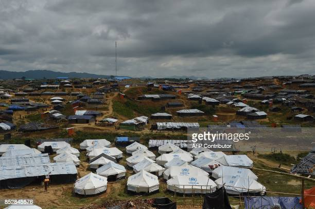 General view shows tents Rohingya refugees and UN Refugee Agency tents at the Kutupalong refugee camp on September 24, 2017. Nearly 430,000 refugees...