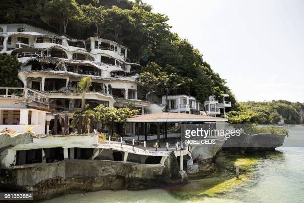 TOPSHOT A general view shows the almost demolished West Cove Hotel on the Philippine island of Boracay on April 26 2018 The Philippines shuttered its...