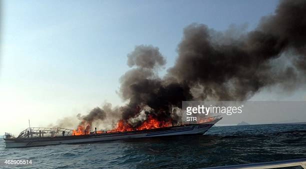 A general view shows the burning Phuket ferry near Noppharat Thara beach in Krabi province on April 8 2015 Scores of foreign tourists endured a...