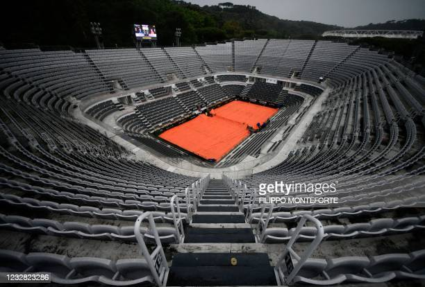 General view shows the central court covered with tarp after the match between Serbia's Novak Djokovic and US Taylor Fritz was suspended due to...