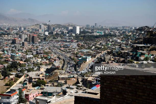 General view shows the city from the top of a hillside, in Kabul on October 25, 2020.
