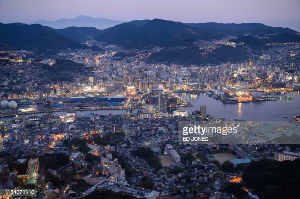 A general view shows the city skyline and port of Nagasaki at Mount Inasayama on November 23 2019 Pope Francis will visit Japan from November 23 to...