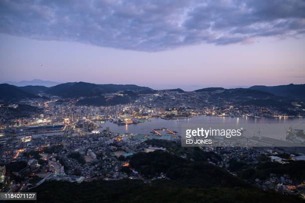 General view shows the city skyline and port of Nagasaki at Mount Inasayama on November 23, 2019. - Pope Francis will visit Japan from November 23 to...