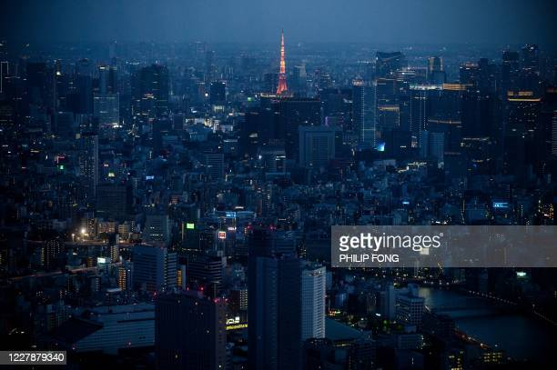 General view shows the city skyline and Tokyo Tower from the observation deck of Tokyo Skytree in Tokyo on August 2, 2020.