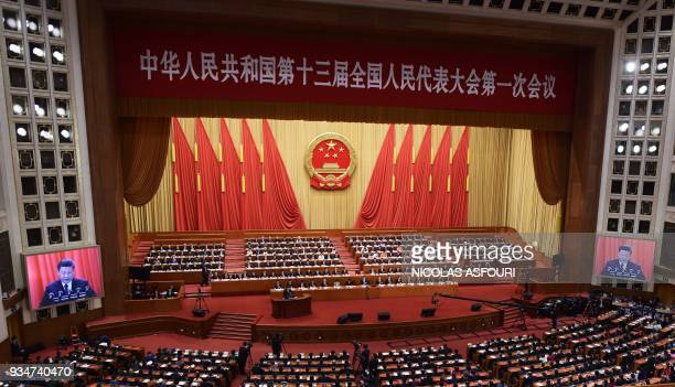 General view shows the closing session of the National People's Congress as Chinese President Xi Jinping delivers a speech in Beijing's Great Hall of...