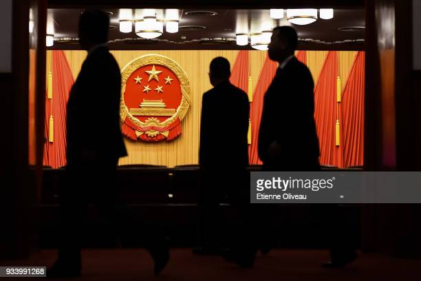 General view shows the coat of arms of the People's Republic of China displayed in the Great Hall of the People before the seventh plenary session of...
