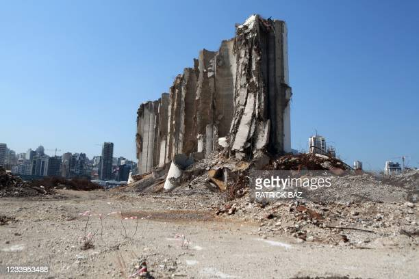 General view shows the damaged grain silos at the port of the Lebanese capital Beirut on June 13 almost a year after the August 4 massive explosion...