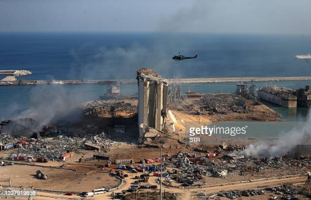 TOPSHOT A general view shows the damaged grain silos of Beirut's harbour and its surroundings on August 5 one day after a powerful twin explosion...