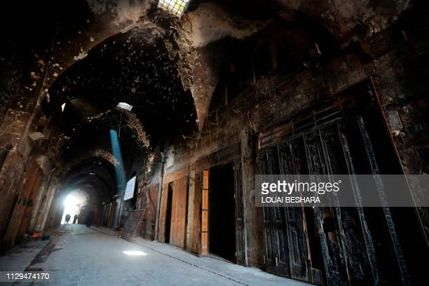 TOPSHOT A general view shows the damaged inflicted on the Old Aleppo markets in the old quarter of Syria's second city of Aleppo on February 12 2019...
