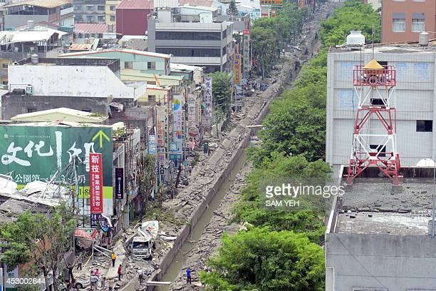 A general view shows the damaged road after gas explosions in the southern Taiwan city of Kaohsiung on August 1 2014 A series of powerful gas blasts...