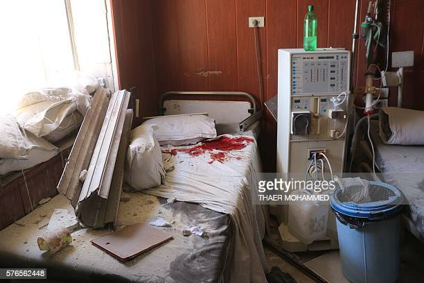 A general view shows the dammage at the Omar bin Abdaziz hospital in the Maadi district of the northern Syrian city of Aleppo after a barrel bomb...