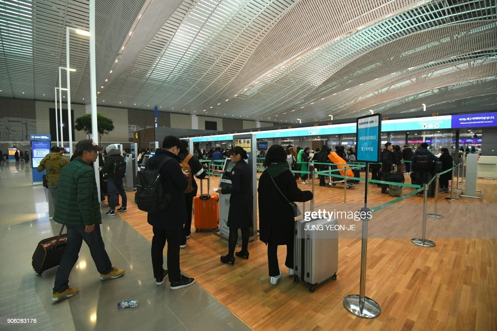 A general view shows the departure lobby at Terminal 2 of Incheon International Airport, west of Seoul, on January 18, 2018. Incheon airport, South Korea's top gateway, on January 18 opened its second terminal, three weeks before the opening of the Pyeongchang Olympics, airport authorities said. Terminal 2 houses four airlines -- South Korea's flag carrier Korean Air, Air France, Delta, and KLM Royal Dutch Airlines.