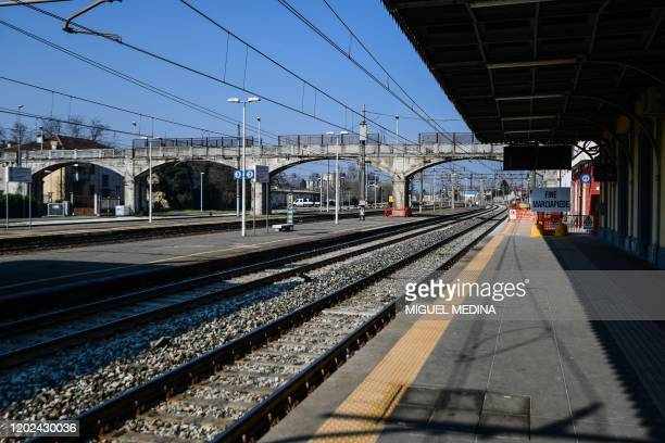 General view shows the deserted railway station in Codogno, southeast of Milan, on February 22, 2020. - Streets were deserted and residents warned to...