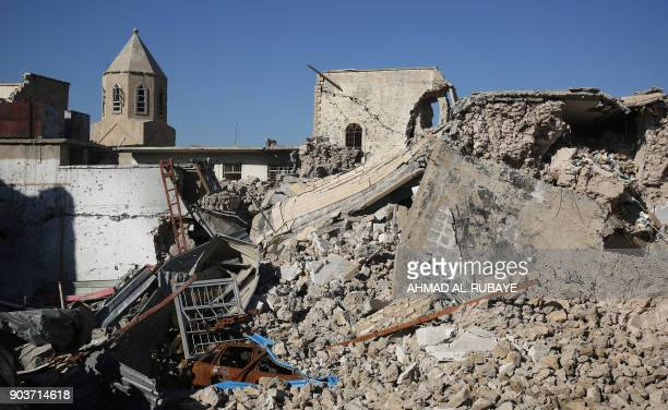 A general view shows the destruction around the Church of Saint George in the old city of Mosul on January 9 2018 Along the waterfront of the Tigris...