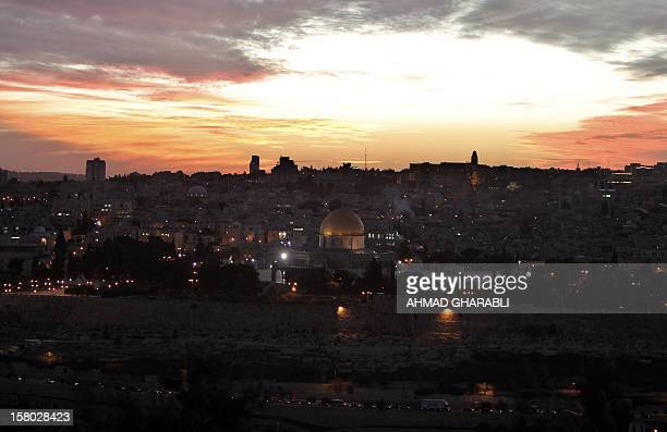 A general view shows The Dome of the Rock located in the AlAqsa mosque compound as the sun sets over Jerusalem's Old City on December 9 2012 AFP...