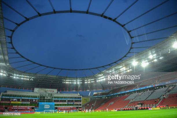 General view shows the empty stands during the German first division Bundesliga football match Bayer Leverkusen v FC Cologne on June 17, 2020 in...